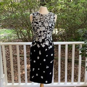 Black fitted dress with white embroidered flowers